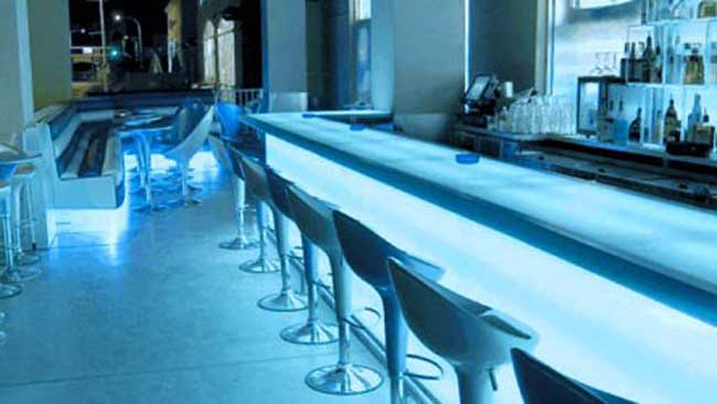 white bar illuminated with blue accent lighting