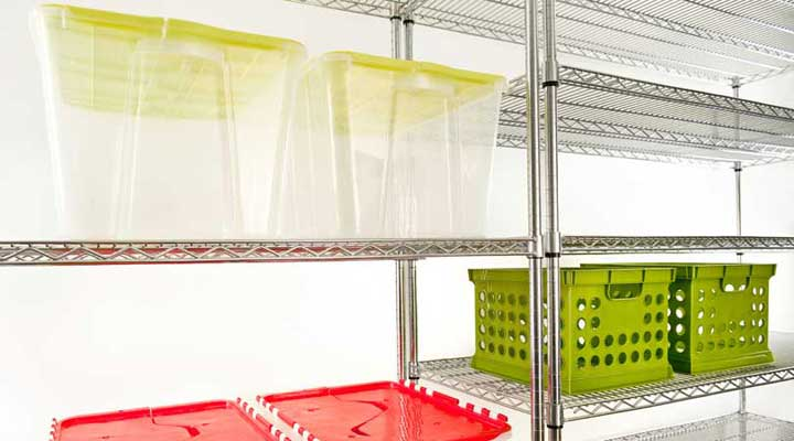 clear plastic bins on large metal shelves