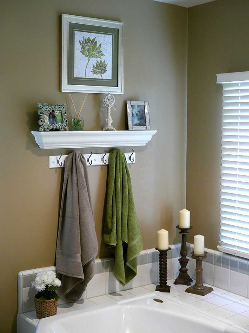 crown molding photo ledge over a hand towel rack