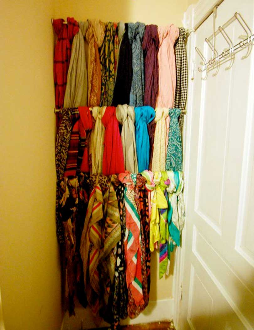 tension rods tucked behind a corner door hold scarves