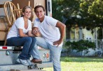 couple posed outside their moving truck 145x100