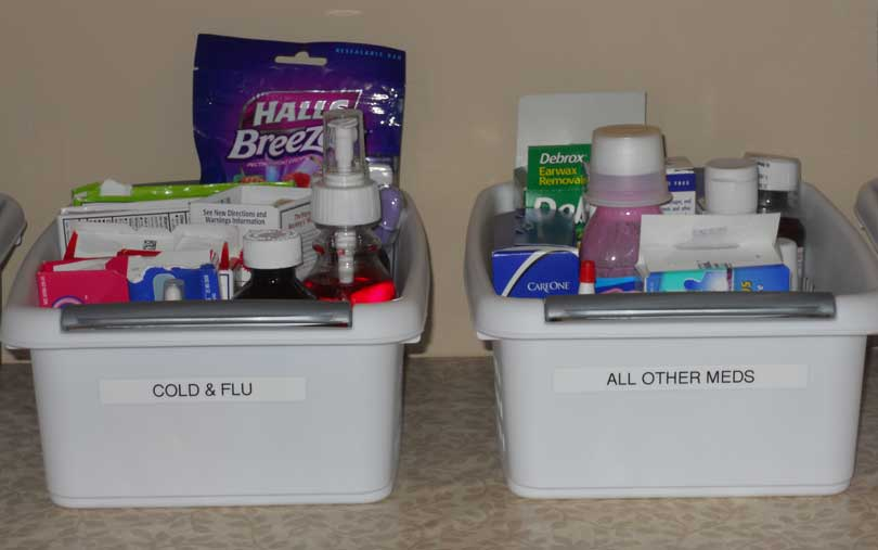 two labeled bins full of medication