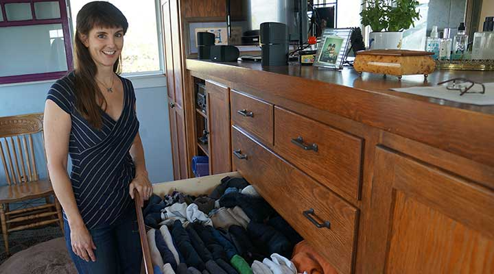 professional organizer nonnahs driskill standing in front of a drawer she organized