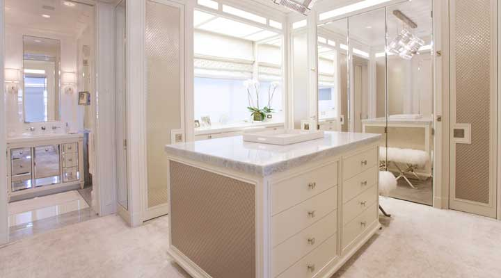closet design room with marble counter tops