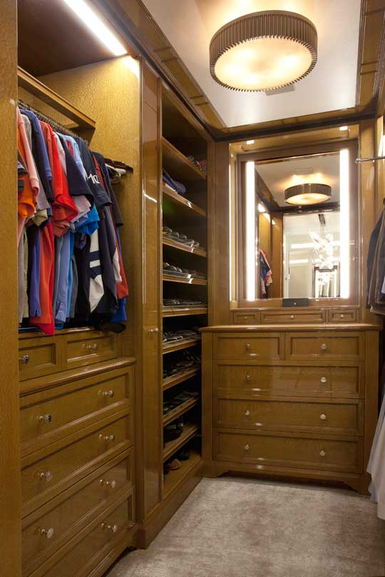 man's luxury wood paneled wardrobe room
