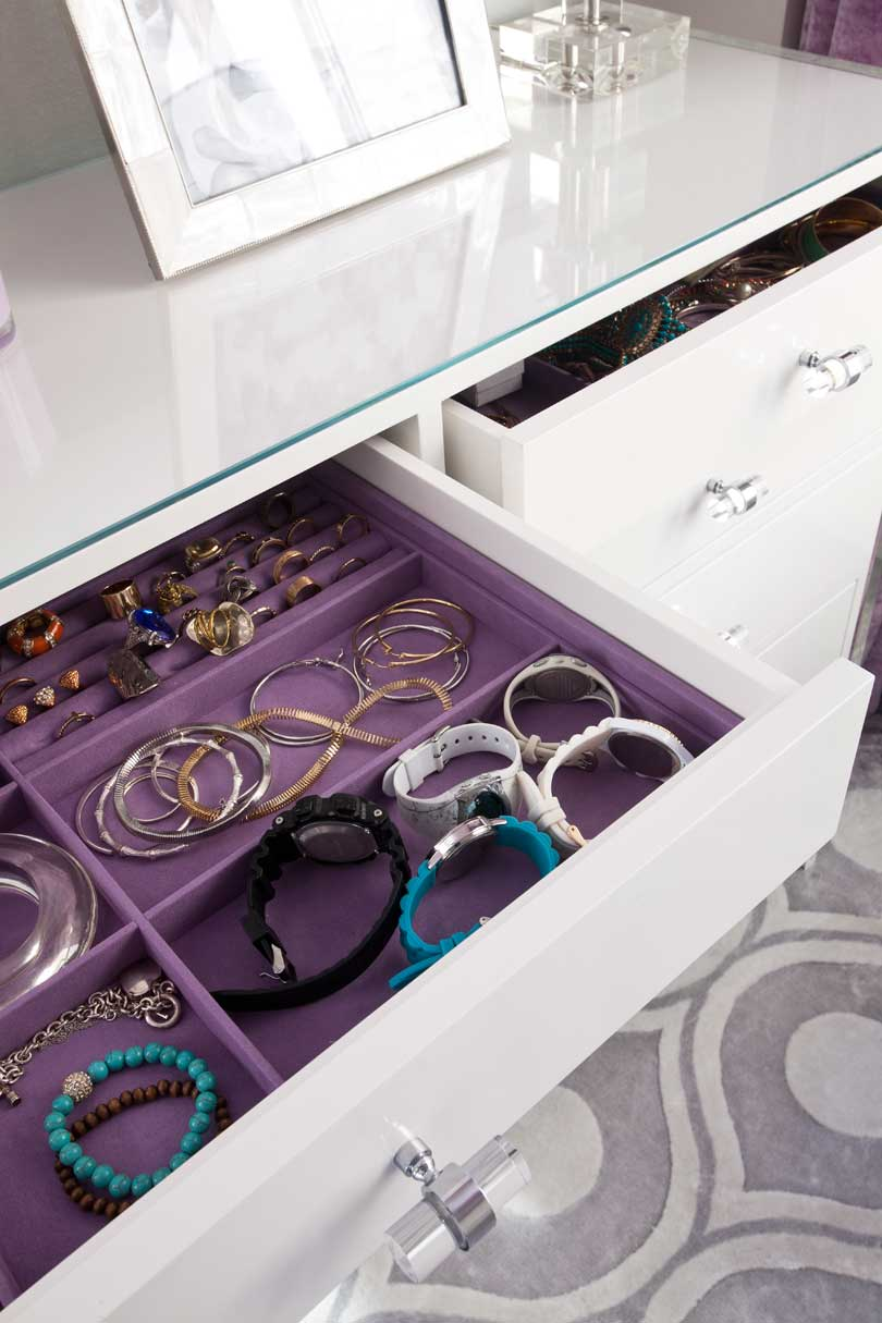 purple fabric lined jewelry drawer in closet room