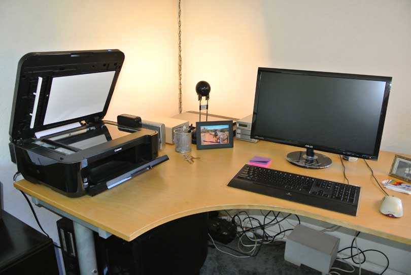 scanner and computer on desk paperless
