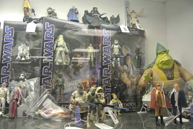 Star Wars action figures in and out of boxes