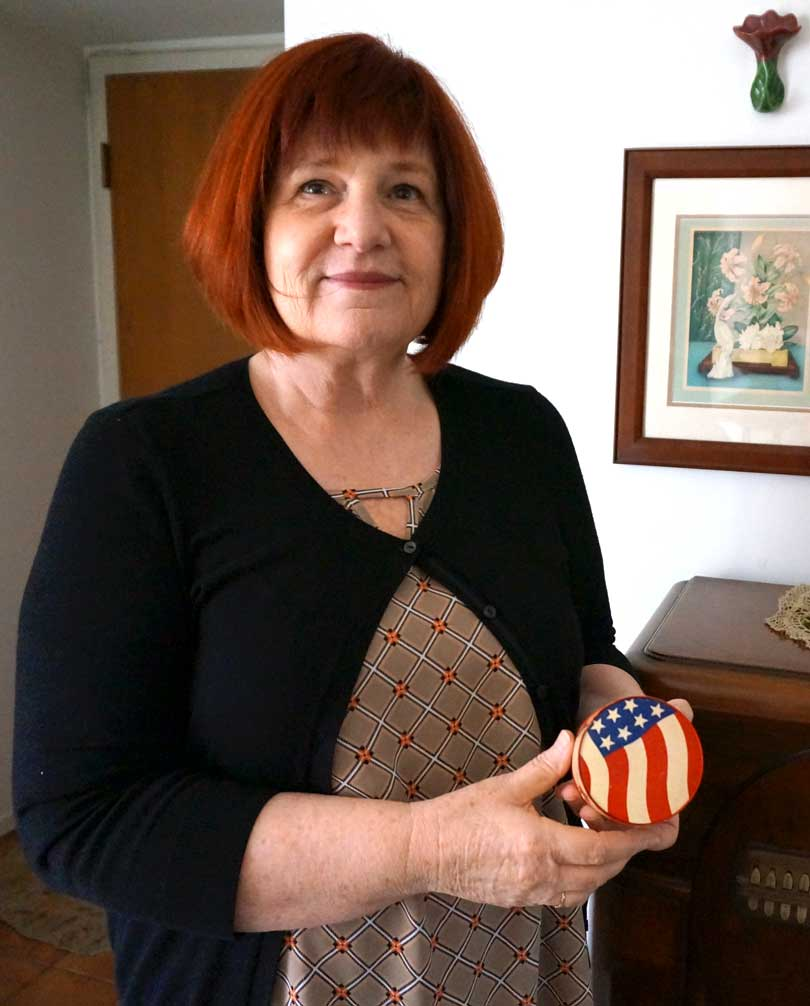 collector shows off patriotic vintage makeup compact from wwii