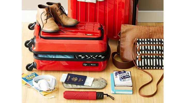 packing light illustration with suitcase and passport