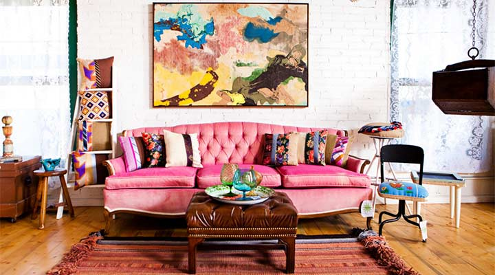 vintage chic living room with a pink couch anchoring pink and purple finds