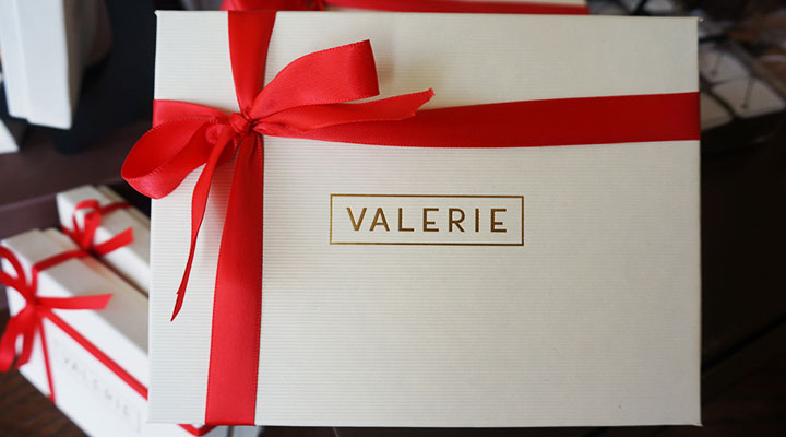 box of valerie chocolates wrapped in red ribbon