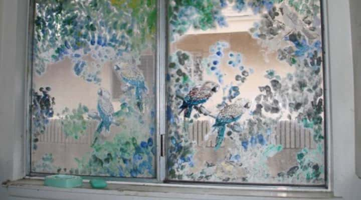 view of painted birds on windows in a fixer upper house