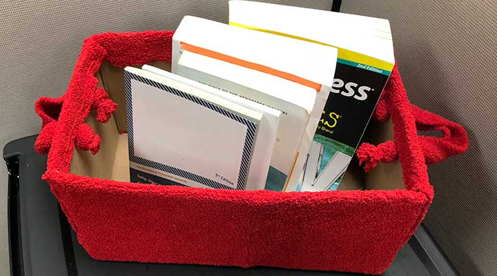 red sweater box storing books