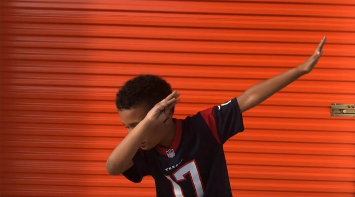 young public storage customer doing the dab dance move