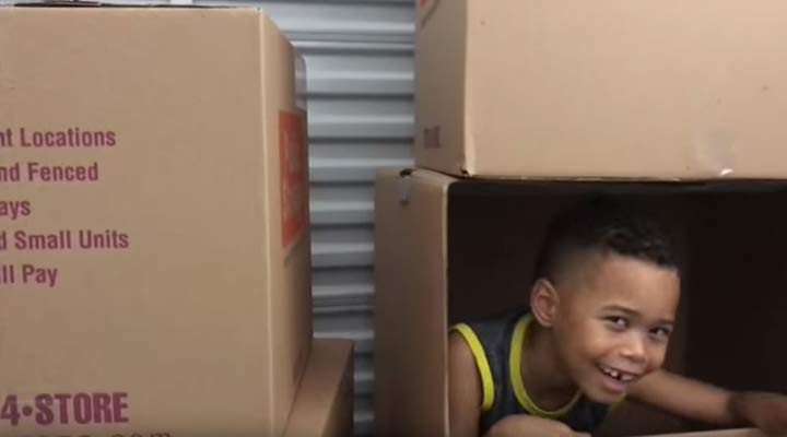 kid in public storage boxes