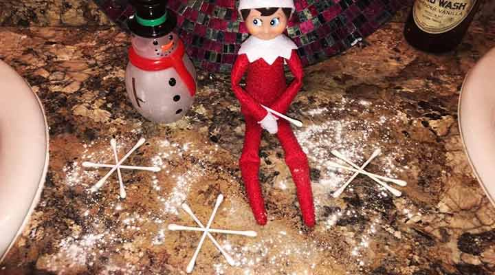 elf on the shelf in the bathroom with cotton swabs