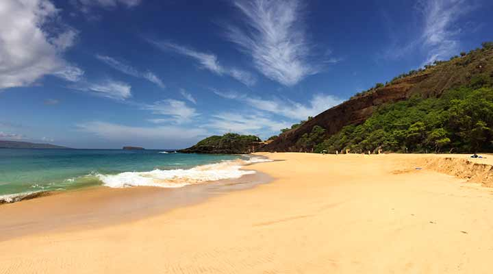 view of Maui beach on a sunny and blue sky day