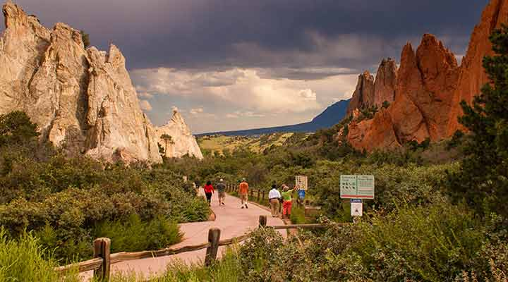 people walking main trail entrance of garden of the gods