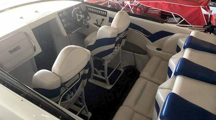 blue and white seating cabin of power boat in storage