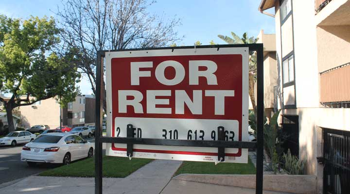 closeup of an apartment for rent sign