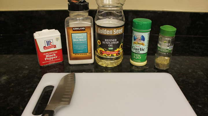 kitchen workspace with spices organized along white cutting board