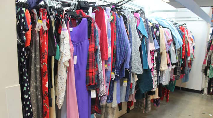rack of textiles and clothes at Goodwill Los Angeles