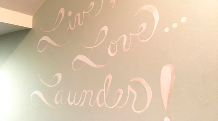 Live, Love, Launder painted on wall