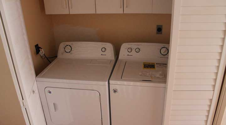 washer and dryer in hallway laundry room