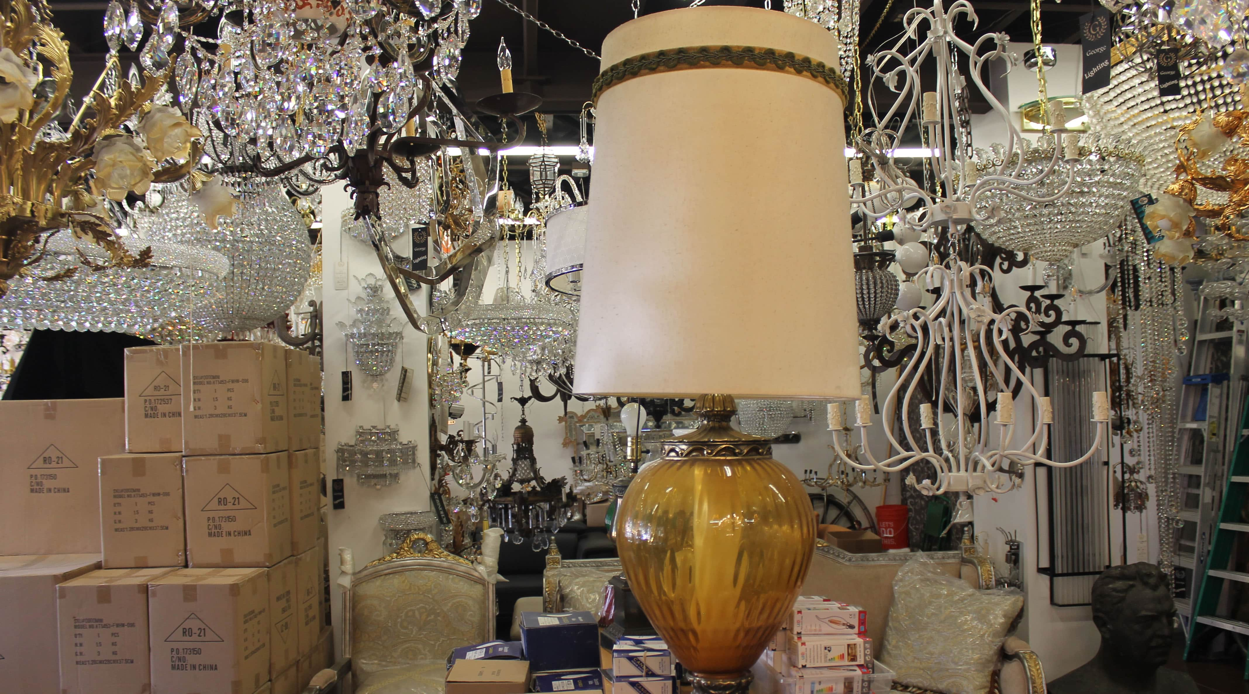shop filled with vintage chandeliers and lamps