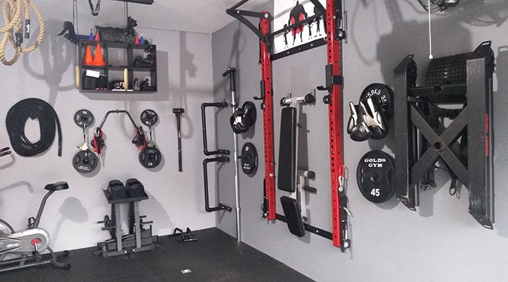 garage home gym workout equipment stored on walls