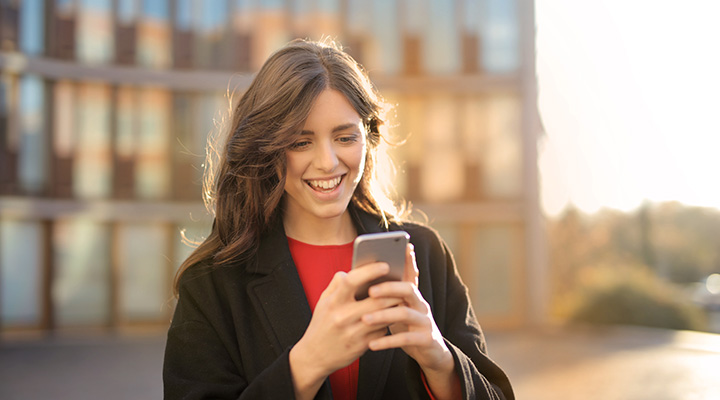 Woman looking at Public Storage contest on her mobile phone