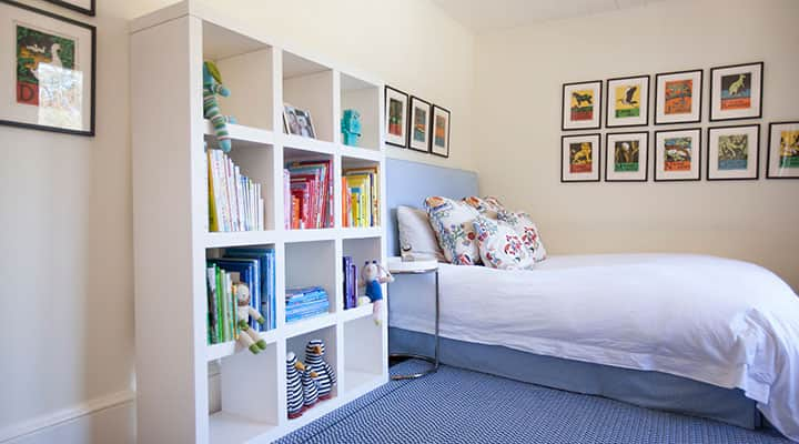 Organized childrens bedroom with toys and books in storage bins