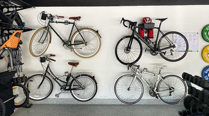 four bicycles are stored on a bike wall mount