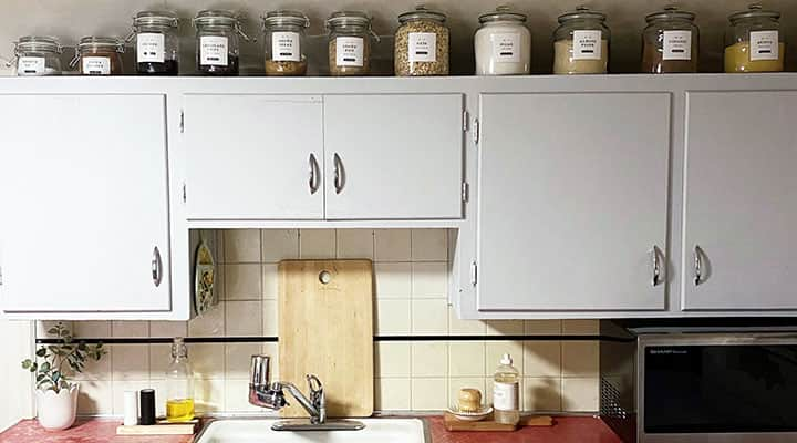 kitchen using hygge with food in storage containers and neutral tone cabinets