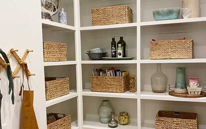 hygge pantry organized using different textures such baskets and wire containters