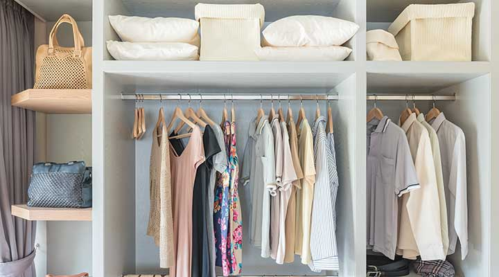 organized summer clothes in closet