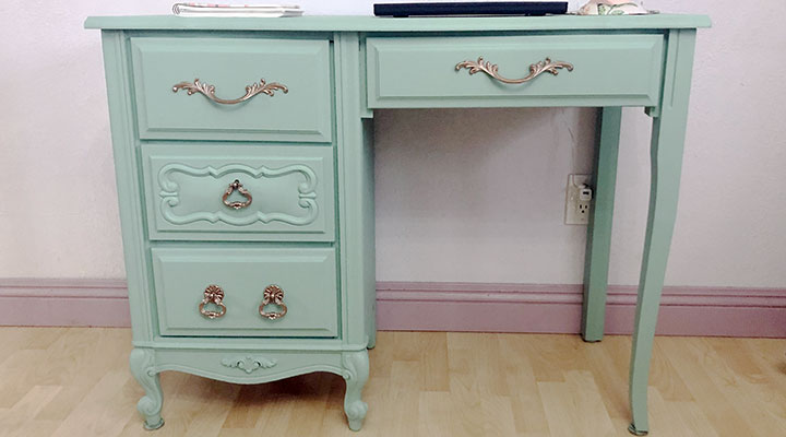 pale green desk against the wall