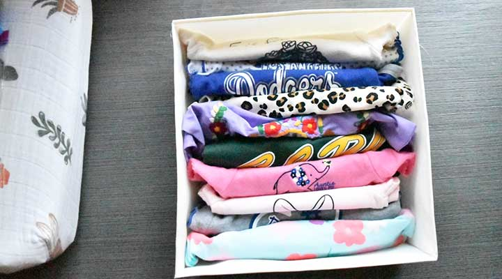view of baby clothes file folded in bin