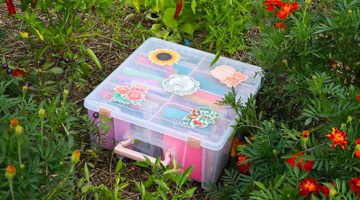 closeup of seed storage container in garden