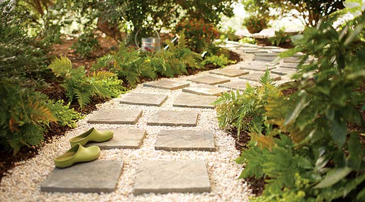 curved stone walking path with clogs and plants