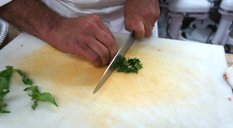 roll basil leaves then slice into a chiffonade