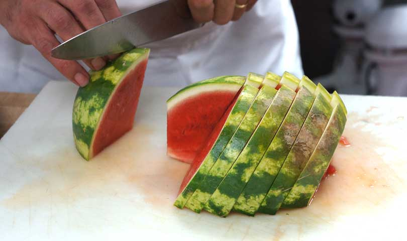 slice a seedless watermelon into half inch thick wedges