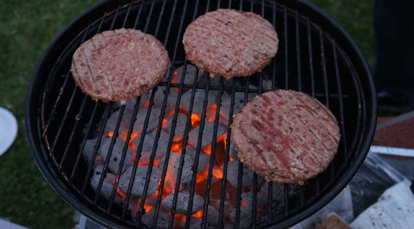 burger patties on the grill