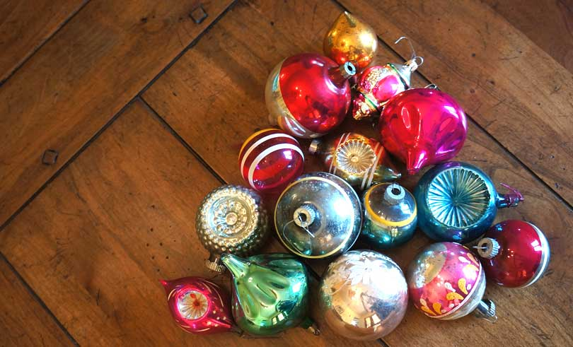 vintage Christmas ornaments laid out on a table