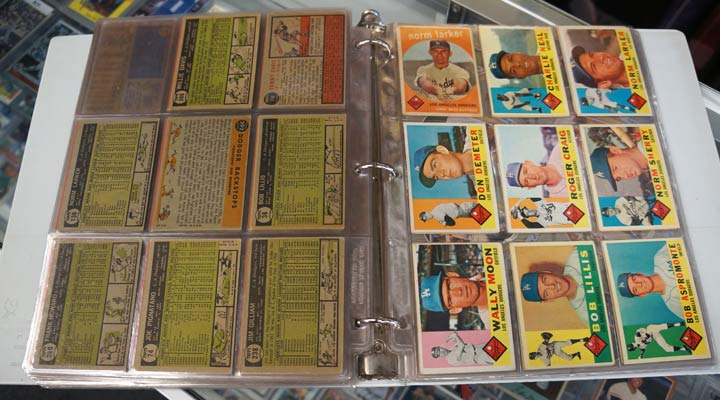 baseball card storage in plastic sleeves in a notebook with dodger cards