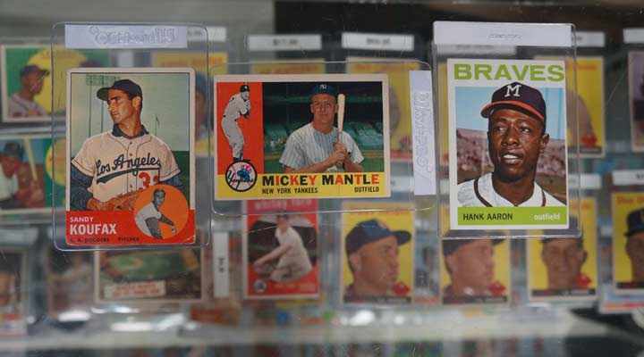 Baseball cards for some of the most popular players: Sandy Koufax Mickey Mantle and Hank Aaron
