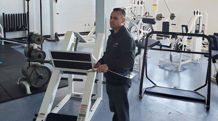 mover inspects fitness equipment