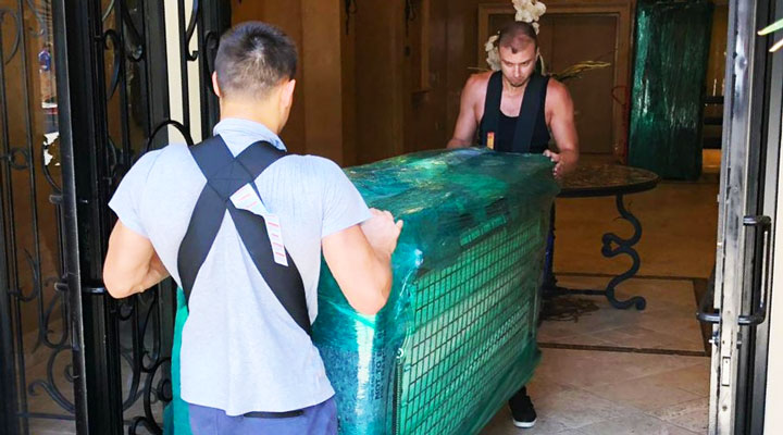 movers carrying furniture